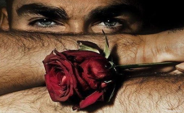 man-with-beautiful-eyes-holding-a-rose-wallpaper